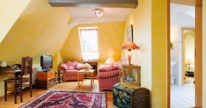 Ein Sitzbereich in der Unterkunft Landhaus Artischocke