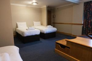 A bed or beds in a room at Ramada Birmingham/Sutton Coldfield