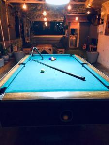 A pool table at Kokos Hostel Padang City