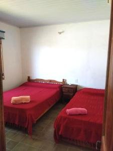 A bed or beds in a room at las cuatro eme