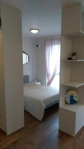 A bed or beds in a room at PL Studija