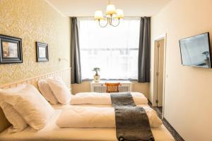 Een bed of bedden in een kamer bij Duke of Ghent