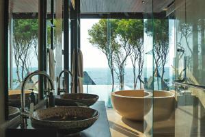 A bathroom at Silavadee Pool Spa Resort - SHA Plus