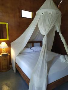 A bed or beds in a room at Full Moon hostel