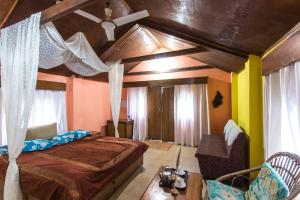 A bed or beds in a room at The Leopard Den by Vista Rooms