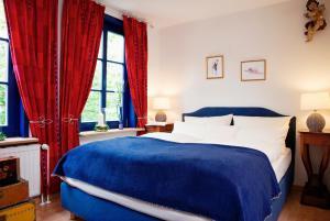 Ein Bett oder Betten in einem Zimmer der Unterkunft Landhaus Artischocke