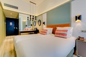 Cama o camas de una habitación en Vincci Baixa