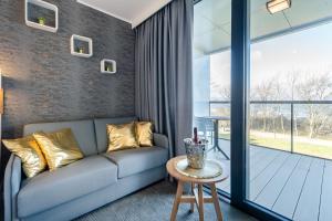 A seating area at Apartamenty Almar Seaside Park Private