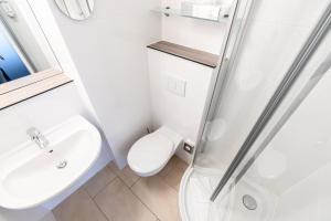 A bathroom at Hotel Demas City