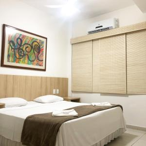 Cama ou camas em um quarto em Pousada Areia do Forte