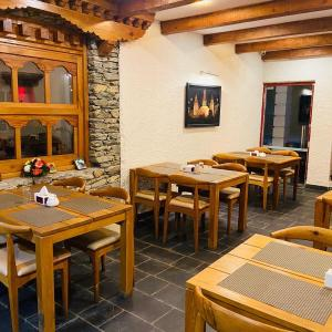 A restaurant or other place to eat at Three Jewels Boutique Hotel