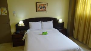 A bed or beds in a room at Suites Larco 656 Miraflores Lima