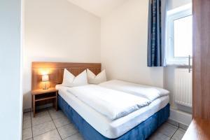 Кровать или кровати в номере Hotel Fresh INN