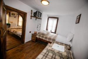 A bed or beds in a room at The Tinkov house in Lovech