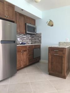 A kitchen or kitchenette at Renovated Beachfront Penthouse Unit!! Views! Views! Views!