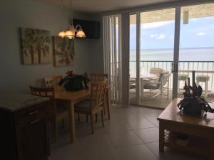 A restaurant or other place to eat at Renovated Beachfront Penthouse Unit!! Views! Views! Views!