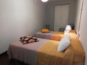 A bed or beds in a room at Camino de Estrellas