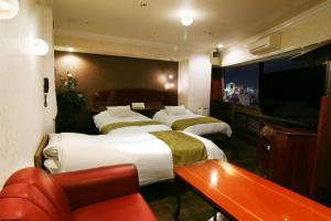 A bed or beds in a room at Hotel Alps (Adult Only)