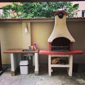 Налични за гости удобства за барбекю в къщата за гости