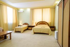 Кровать или кровати в номере SV Hotel