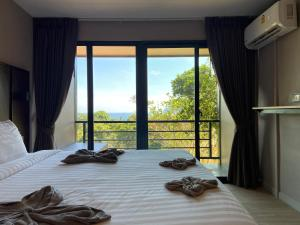 A bed or beds in a room at HIP Seaview Resort @ Phi Phi
