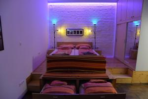 A bed or beds in a room at Katona Apartments
