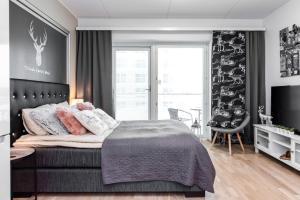 Vuode tai vuoteita majoituspaikassa Trendy Homes Oulu Rautatienkatu 19
