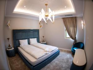 A bed or beds in a room at GALLA Residence