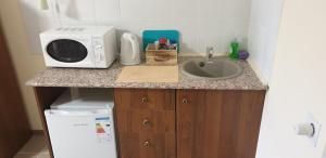 Кухня или мини-кухня в Мотель Как Дома