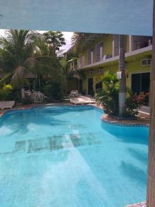A piscina localizada em Pousada Aquarius ou nos arredores