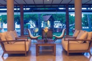 The lobby or reception area at Ranweli Holiday Village