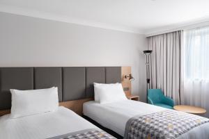 A bed or beds in a room at Holiday Inn Hemel Hempstead M1, Jct. 8, an IHG Hotel