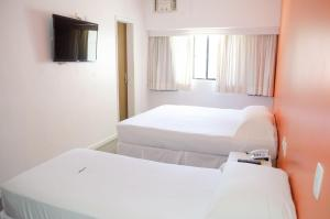 A bed or beds in a room at Bahia Sol e Mar