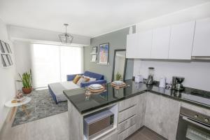 A kitchen or kitchenette at Trendy Host Stelar Miraflores