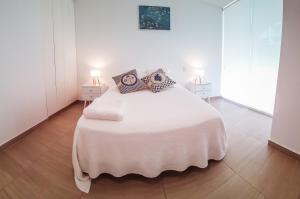 A bed or beds in a room at Departamento de playa - Condominio OCEAN REEF - SAN BARTOLO