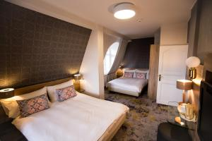 Un pat sau paturi într-o cameră la Mercure Sibiu Airport