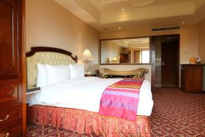 A bed or beds in a room at Rido Hotel