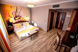 Cama o camas de una habitación en G Empire