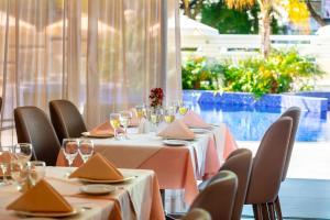 Een restaurant of ander eetgelegenheid bij Kapetanios Odyssia