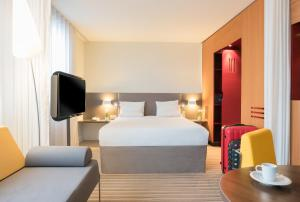 A bed or beds in a room at Novotel Suites Cannes Centre