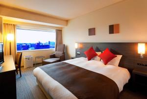A bed or beds in a room at Century Royal Hotel Sapporo