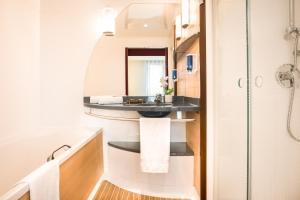 A kitchen or kitchenette at Novotel Suites Cannes Centre