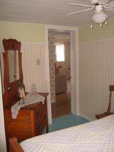 A bed or beds in a room at Le Nid de L'Anse