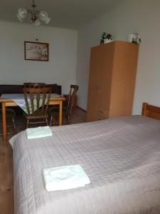A bed or beds in a room at Boróka Vendégház