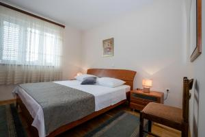 A bed or beds in a room at Apartments Dionis