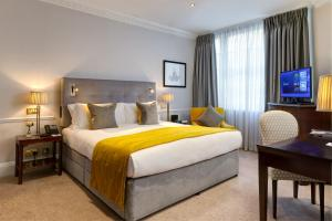 A bed or beds in a room at Dukes London