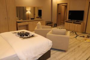 Uma área de estar em Msharef Al Alam Suites Jazan