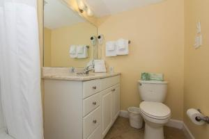 A bathroom at Peppertree by the Sea by Capital Vacations