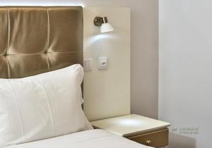 A bed or beds in a room at Urban Hotel Estacao