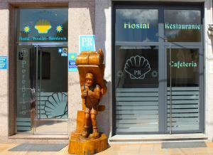 The facade or entrance of Peregrino